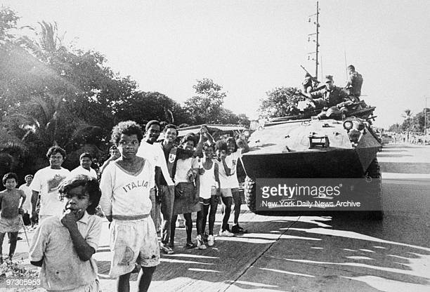 Children cheer Marines following offensive in Vecca Monte west of Panama City during Operation Just Cause the name given to the US invasion of Panama...