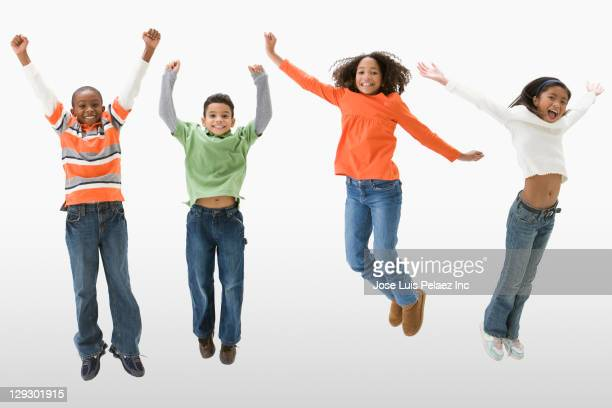 Children cheering and jumping