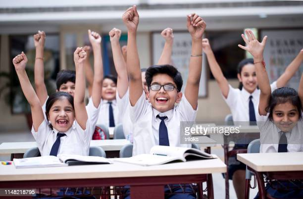children cheering in classroom - indian culture stock pictures, royalty-free photos & images