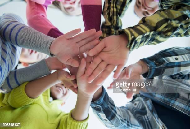Children cheering in huddle