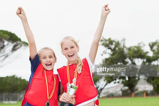 Children cheering with medal