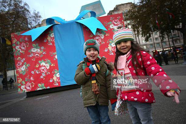 Children Chloe and Michael are pictured in front of a giant Christmas present covered in iconic Cath Kidston print at Marble Arch to celebrate the...