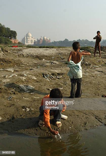 Children clean themselves after defecating in the open air on the banks of the Yamuna river in Agra India on Tuesday Nov 25 2008 The polluted Yamuna...