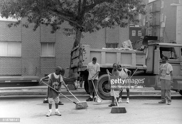 Children cleaning during the Afro American Newspapers Clean Block urban beautification campaign Baltimore Maryland 1996