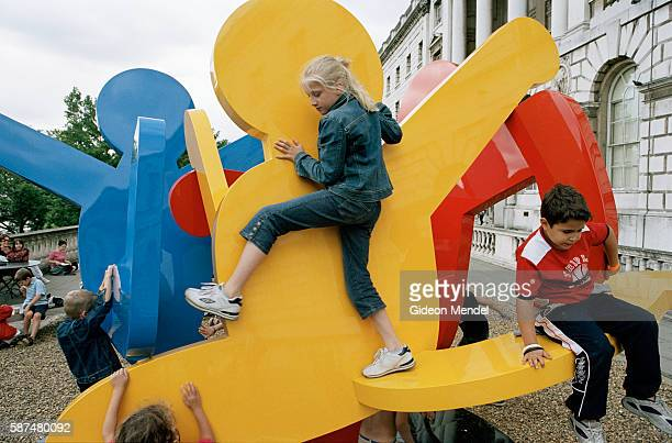 Children climb and play on a monumental Keith Haring sculpture during Free Time an openair Arts Festival for families held every summer at Somerset...
