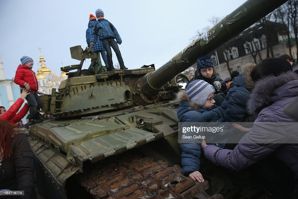 Children climb onto a heavy tank that is part of an exhibition of weapons, drones, documents and other materials the Ukrainian government claims it recovered in eastern Ukraine and prove direct Russian involvement in the fighting between Ukrainian troops and pro-Russian separatists on February 22, 2015 in Kiev, Ukraine. Russia has denied sending heavy weaponry to the separatists, admitting only that Russian volunteers are participating in the fighting.