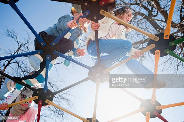 Children climbing on jungle gym