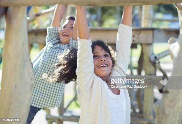 Children climbing on monkey bars