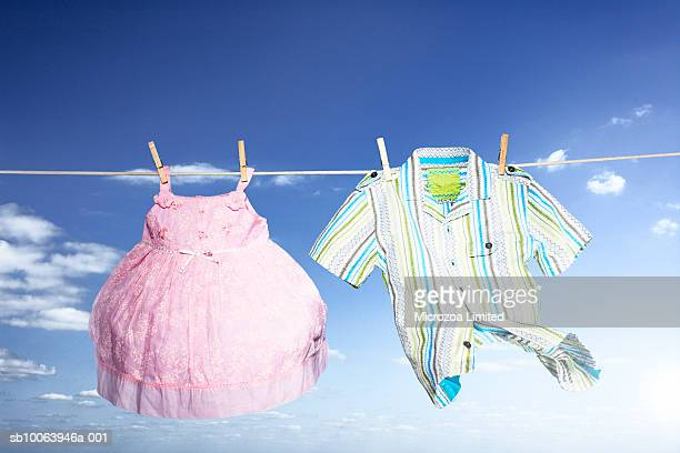 children clothes hanging on washing line, low angle view - microzoa stock pictures, royalty-free photos & images