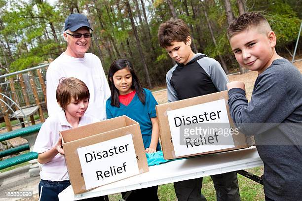Children collecting donations for disaster relief aid. Volunteers, victims