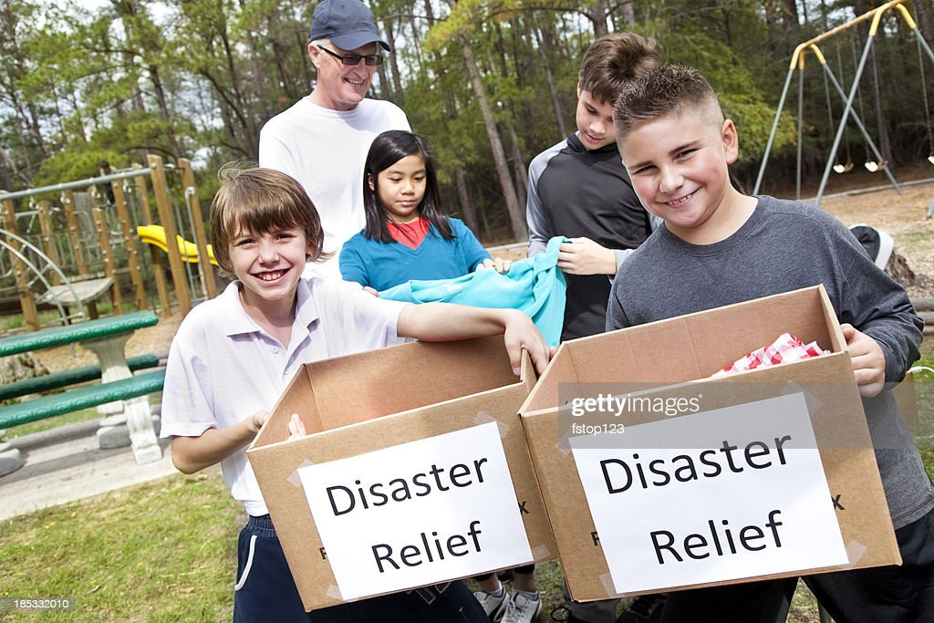 Children collecting for disaster victims : Stock Photo