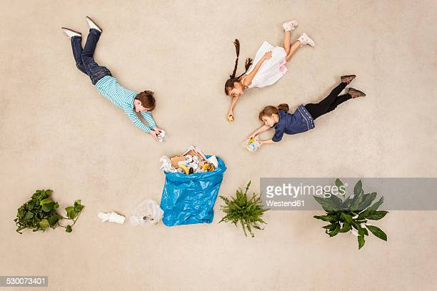 Children collecting garbage in nature
