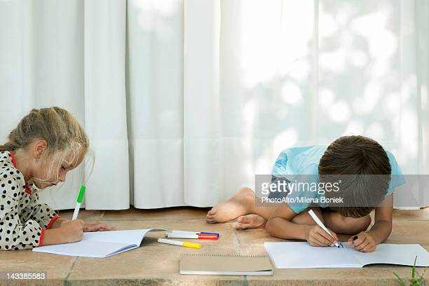 Children coloring on patio