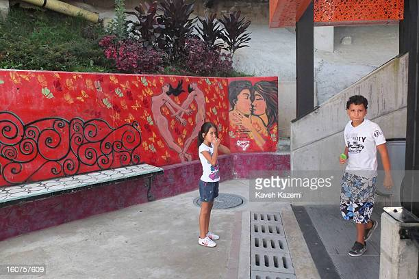 Children come up the escalators in '20 de Julio' neighborhood in the Comuna 13 slums on January 5 2013 in Medellin Colombia The stairway is divided...