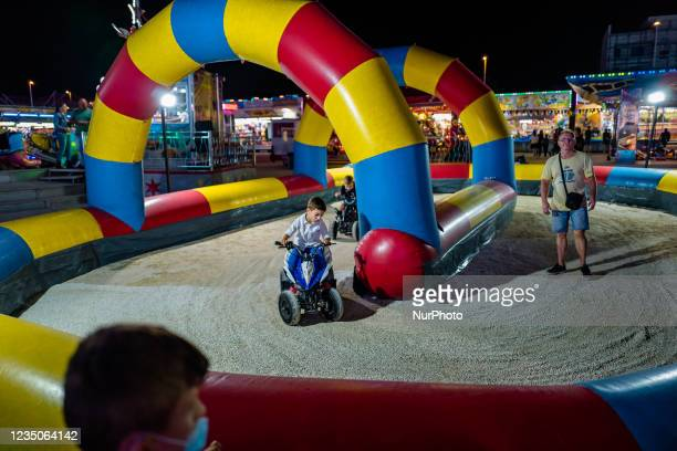 Children compete on scooters, on the first day of the Luna Park opening in Molfetta on 4 September 2021. On the occasion of the Patronal Feast of...