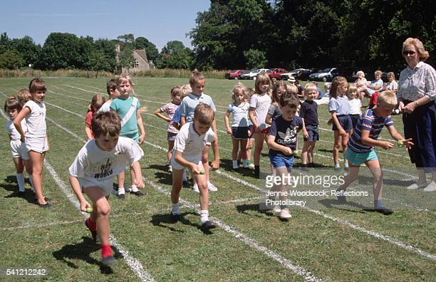Children Competing in Egg and Spoon Race at Castle Combe Village School, UK