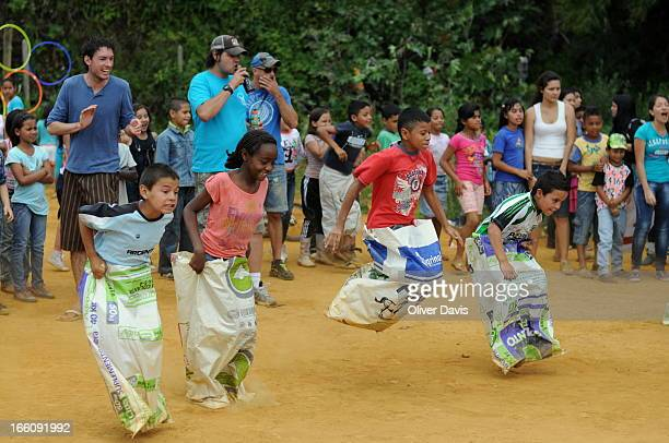 Children competing in sack race during sport's day within a community of displaced families living in the hilltop barrios/slums on the outskirts of...
