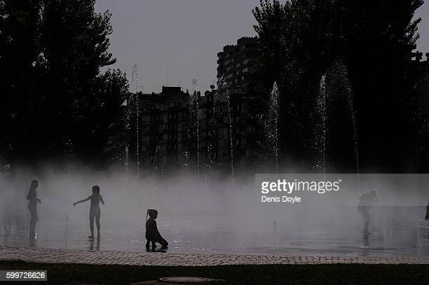 Children cool down in a fountain in the Madrid Rio playground on September 5 2016 in Madrid Spain A threeday heatwave has hit central and southern...