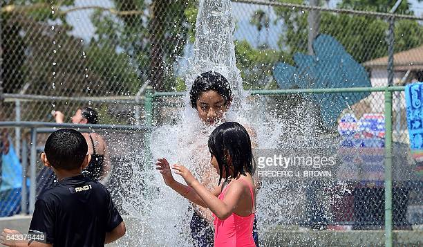 Children cool off at a water park on a hot summer day in Alhambra east of downtown Los Angeles California on June 27 where a hot dry heatwave...