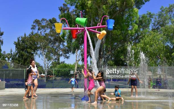 Children cool off on a hot summer day at a water park in Alhambra California on July 3 2018 as southern California braces for a coming heatwave with...