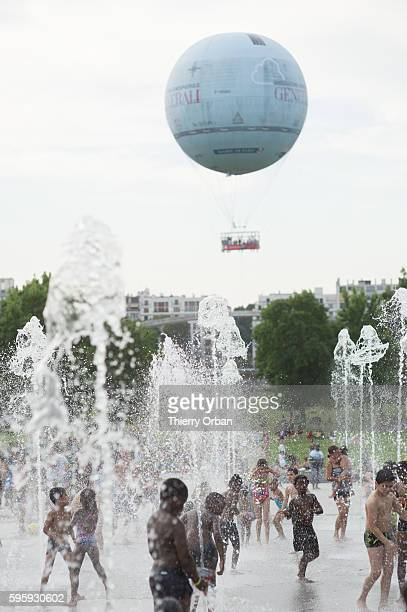 Children cooling off in Parc Andre Citroen during a summer heat wave on August 26 2016 in Paris France The temperature reached 100 fahrenheit degrees...