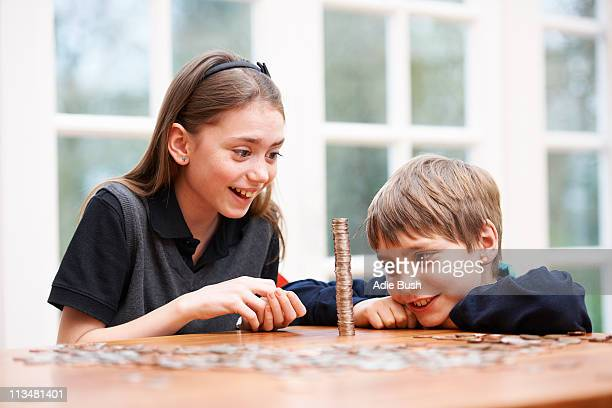 Children counting piles of money