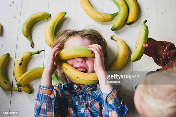 Children (2-3, 4-5) covered in bananas