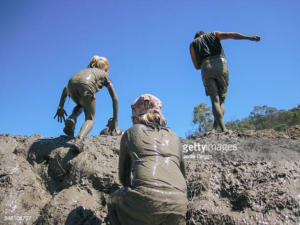 Children covered in mud during obstacle course