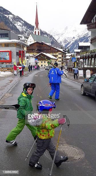 Children cross the main street of the Austrian town of Soelden
