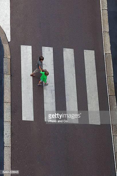 children crossing a pedestrian crossing