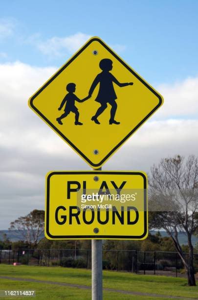 'children crossing' and playground road warning signs - pedestrian crossing sign stock photos and pictures