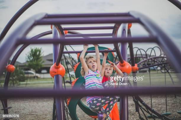 Children crossing monkey bars