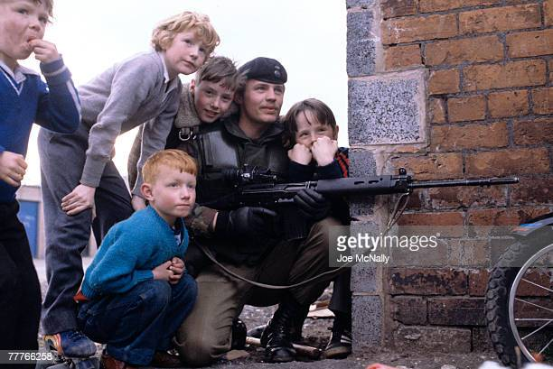 Children crowd around to pose with a soldier in May of 1981 on the streets in Northern Ireland Bobby Sands an active member of the Irish Republican...