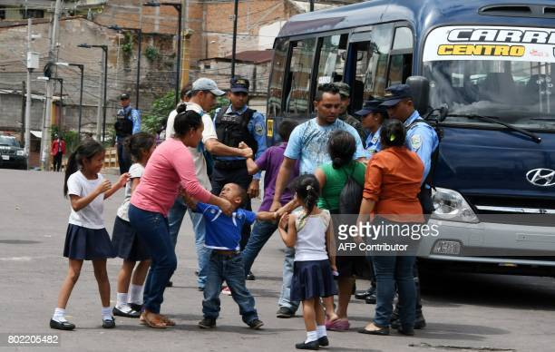 Children cry over the death of their father a bus driver killed by gang members for refusing to pay them a war tax over Soberania bridge which...