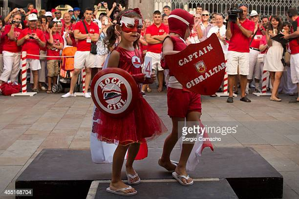 Children customed superheroes participate in the costume contest during Gibraltar National Day celebrations on September 10 2014 in Gibraltar The...