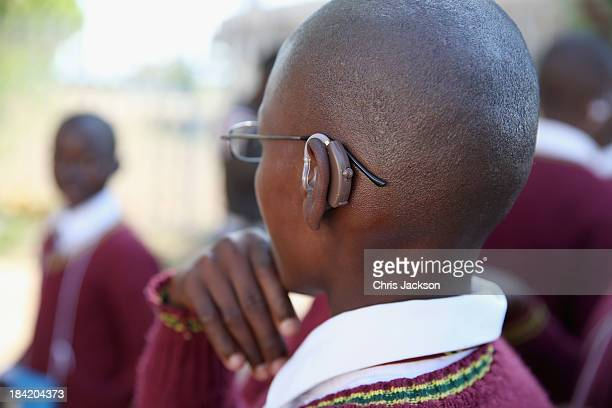 children dance after having hearing aids fitted by the Starkey Foundation at Lesotho Cooperative College on October 10 2013 in Maseru Lesotho Prince...