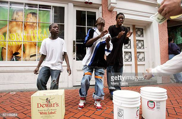 Children dance and sing for money on Bourbon Street during Mardi Gras festivites February 6 2005 in New Orleans Louisiana Festivities will continue...