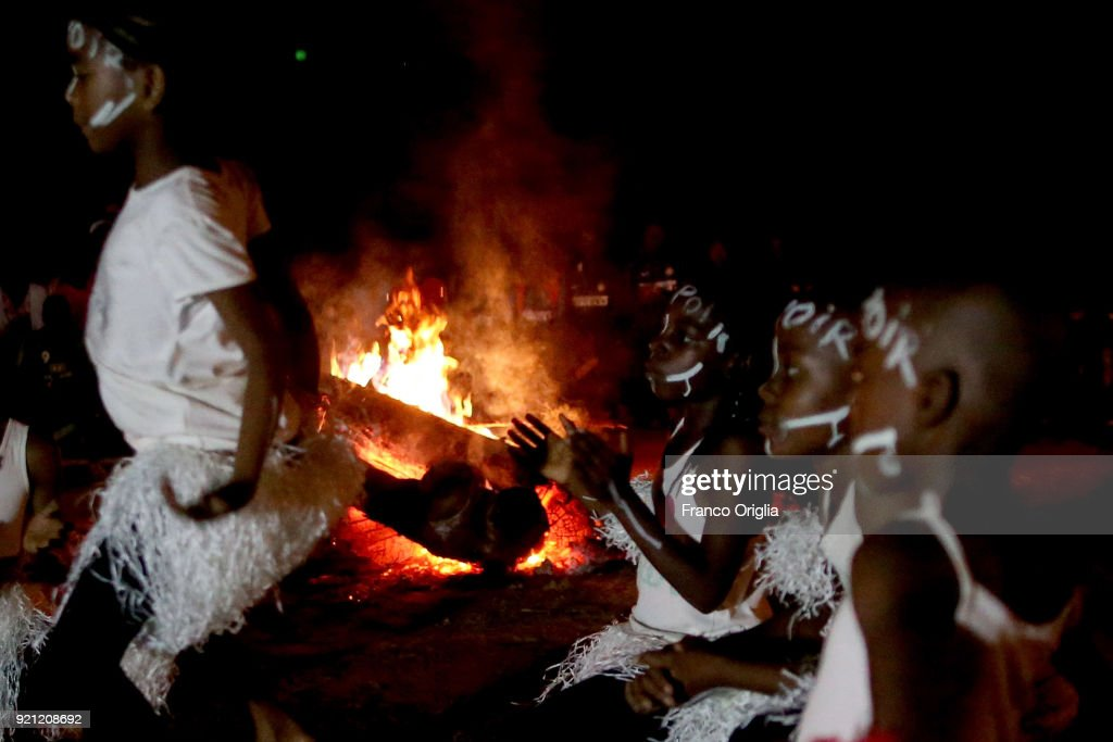 Children dance around a fire in Mbalmayo (village south Yaounde) on February 18, 2018 in Yaounde, Cameroon. Cameroon is often referred to as 'Africa in miniature' for its geological and cultural diversity. Natural features include beaches, deserts, mountains, rainforests, and savannas.