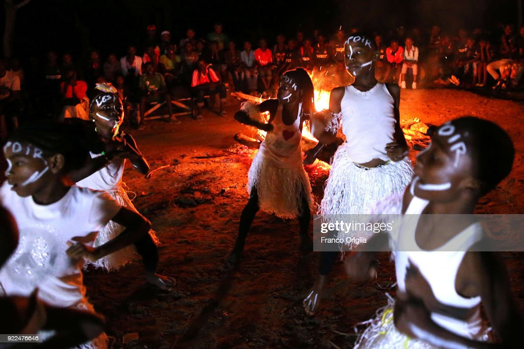Children dance around a fire in the village of Mbalmayo (south Yaounde) on February 19, 2018 in Yaounde, Cameroon. Cameroon is often referred to as 'Africa in miniature' for its geological and cultural diversity. Natural features include beaches, deserts, mountains, rainforests, and savannas.