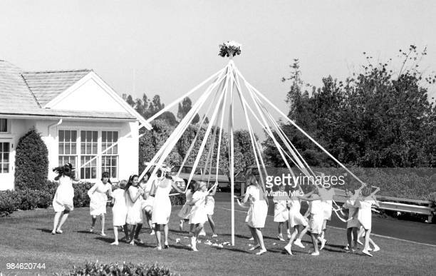 Children dance around a Maypole during May Day at John Thomas Dye elementary school on May 1 1967 in Los Angeles California May Day is a public...
