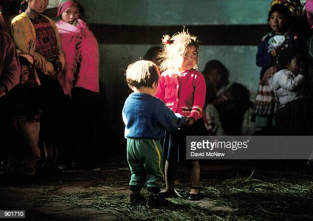 Children dance during a celebration of the arrival of electricity to a small community near Todos Santos Cuchumaten in the Cuchumaten Mountains of...