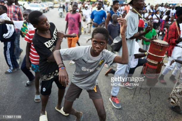 Children dance during a rallye in support of the outgoing Senegal's president Macky Sall on February 21 2019 in Dakar The Senegal's presidential...