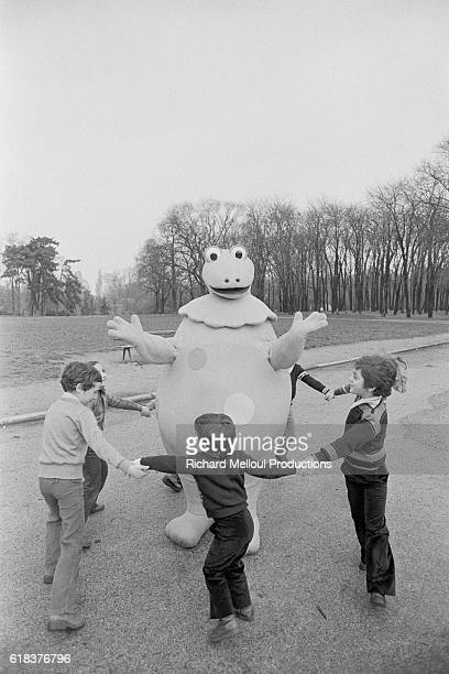 Children dance hand in hand around the friendly monster Casimir, the star of the French children's television show L'Ile aux Enfants.