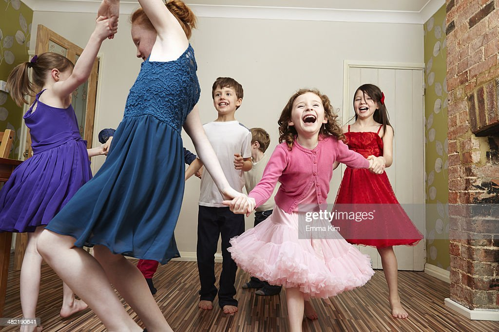 Children dancing at birthday party : Stock Photo