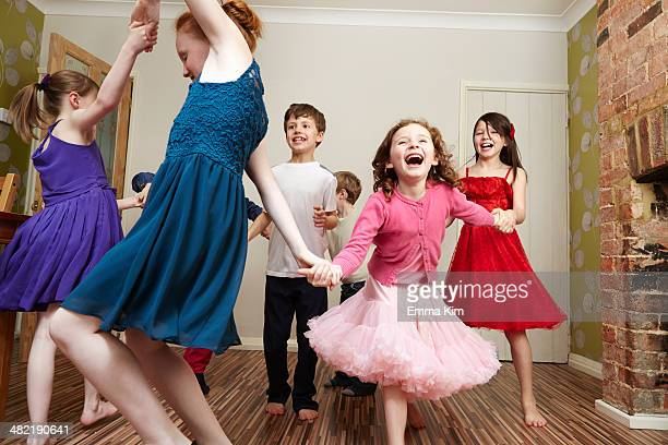 children dancing at birthday party - children only stock pictures, royalty-free photos & images