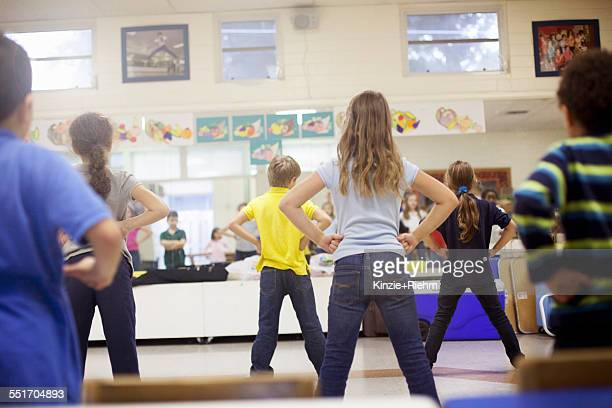 children dancing in classroom - boys wearing tights stock photos and pictures