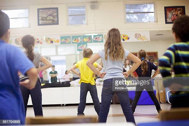 Children dancing in classroom