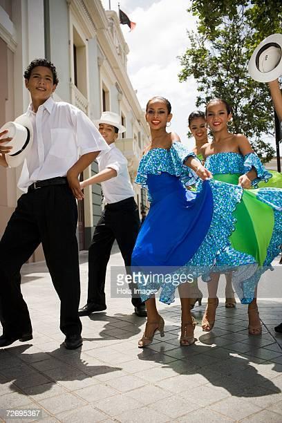 Children dancing Plena, traditional dance, outdoors