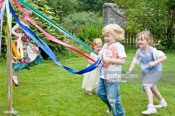Children dancing round a maypole