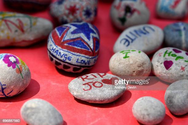Children decorate pebbles as people attend a Great Get Together event in memory of murdered MP Jo Cox on June 17 2017 in Heckmondwike England More...
